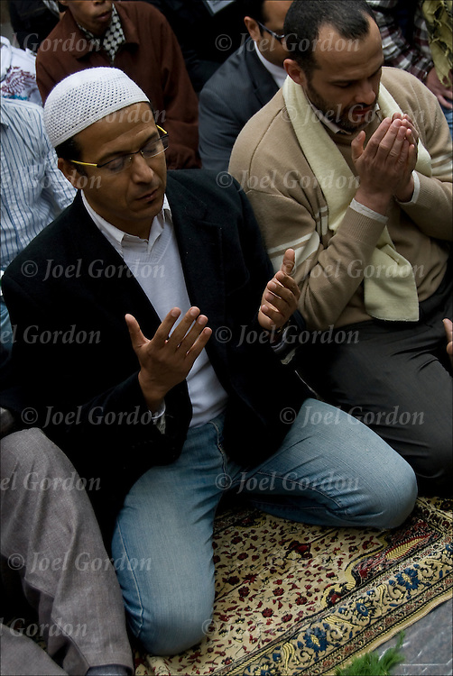Friday prayer, or &quot;jummah&quot; at 1 p.m. in Zuccotti Park with Occupy Wall Street.  Imam Aiyub Abdul Raki of the Isamic leadership Council leads pray and delivered a sermon on social justice in Islam and said that Islamic are part of the 99%ers. <br />