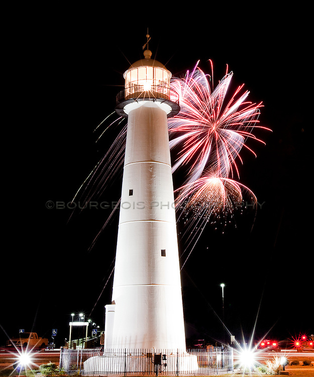The Biloxi lighthouse located along Highway 90 in Biloxi Mississippi.  photo taken at the New Year's welcoming. Biloxi Lighthouse Pier in background.