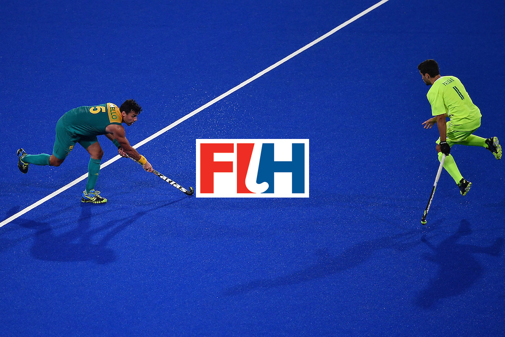 Brazil's Lucas Paixao attempts to block Australia's Chris Ciriello (L) during the mens's field hockey Australia vs Brazil match of the Rio 2016 Olympics Games at the Olympic Hockey Centre in Rio de Janeiro on August, 12 2016. / AFP / MANAN VATSYAYANA        (Photo credit should read MANAN VATSYAYANA/AFP/Getty Images)