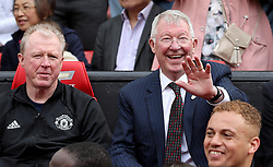Manchester United Legends manager Sir Alex Ferguson (right) in the dugout with Steve McClaren (left) during the legends match at Old Trafford, Manchester.