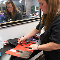 Student Candace Palmer puts away her shears and clippers at the end of the night at the Tupelo Academy of Cosmetology.