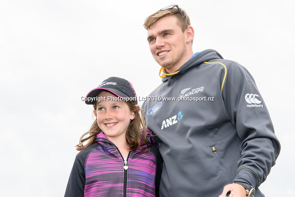 Tom Latham of the Blackcaps poses with a fan during a Blackcaps Barbecue at Hagley Oval in Christchurch, New Zealand. 14 November 2016. Photo: Kai Schwoerer / www.photosport.nz