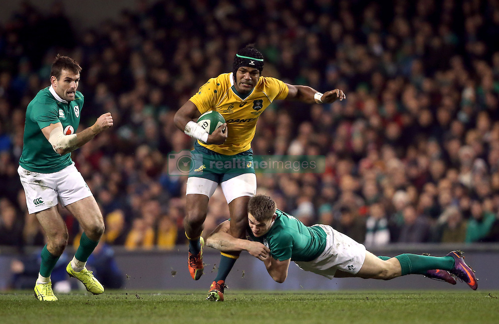 Australia's Henry Speight is tackled by Ireland's Garry Ringrose during the Autumn International match at the Aviva Stadium, Dublin.
