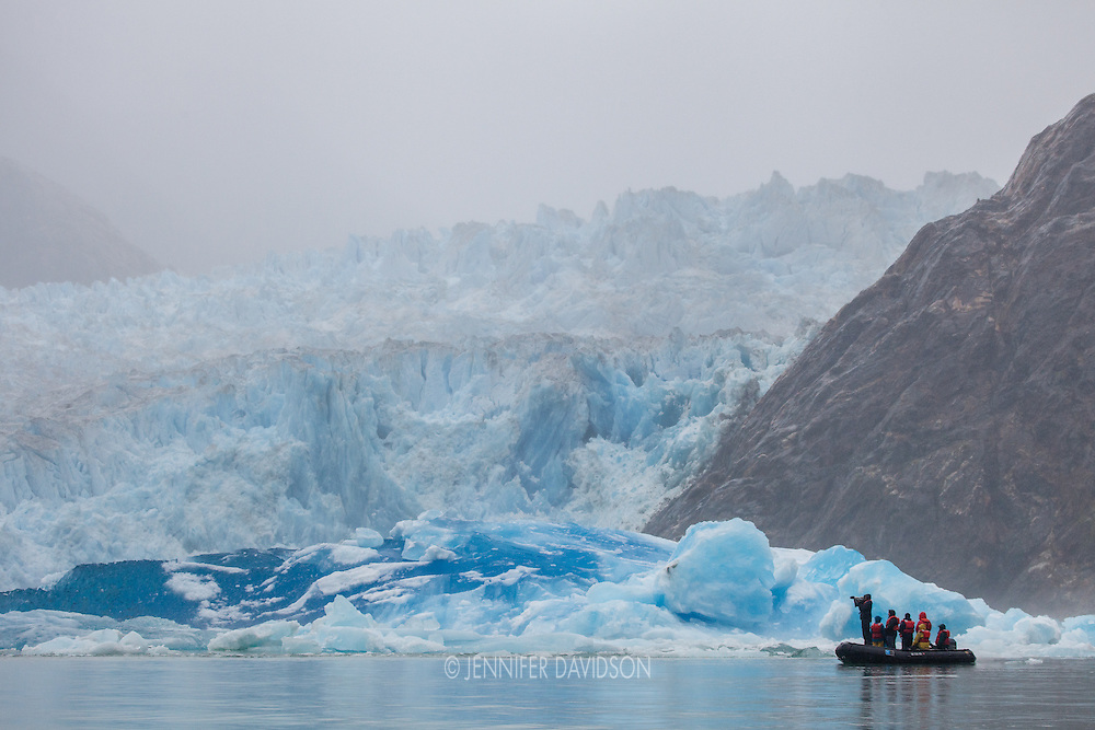 Guests from the National Geographic Sea Lion on an excursion in small inflatable boats in front of South Sawyer Glacier in Tracy Arm, part of the Tracy Arm - Fords Terror Wilderness, Alaska.