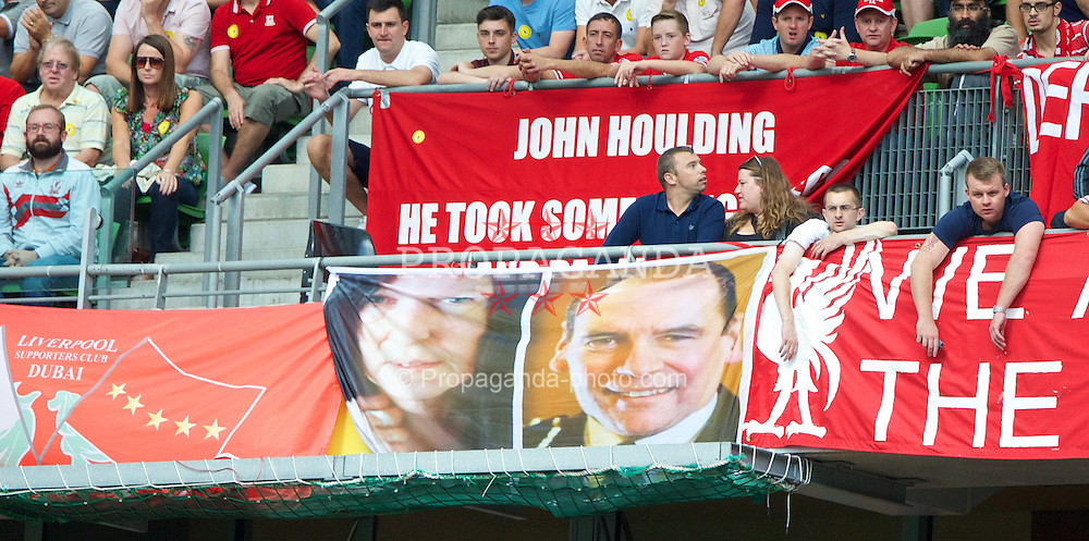 DUBLIN, REPUBLIC OF IRELAND - Saturday, August 10, 2013: Liverpool supporters' banner featuring justice campaigner Anne Williams and Norman Bettison, whom many believe to be the man responsible for the 96 deaths at the Hillsborough Stadium Disaster, during a preseason friendly match against Glasgow Celtic at the Aviva Stadium. (Pic by David Rawcliffe/Propaganda)