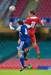 CARDIFF, WALES - Saturday, October 11, 2008: Wales' Sam Vokes and Liechtenstein's Fabio D'Elia during the 2010 FIFA World Cup South Africa Qualifying Group 4 match at the Millennium Stadium. (Photo by Gareth Davies/Propaganda)