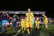 Sutton United's Jamie Collins (6) leads his team out during the The FA Cup match between Sutton United and Arsenal at Gander Green Lane, Sutton, United Kingdom on 20 February 2017. Photo by Phil Duncan.