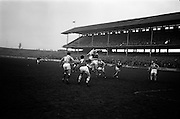 16/02/1964<br /> 02/16/1964<br /> 16 February 1964<br /> Railway Cup Football Semi Final: Munster v Ulster at Croke Park, Dublin. Munster back N. Sheehy (centre) gathers the ball despite efforts of Ulster forward P.J. Treacy (14) to punch the ball into goal. Also in the picture is S. Flynn (7) Munster forward.