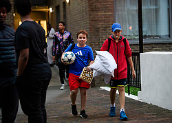 **NOTE TO EDITORS: Children are pictured**<br /> &copy; Licensed to London News Pictures. 23/06/2017. London, UK. Residents being evacuated from the Taplow block of the Chalcots Estate in Camden after it failed a fire inspection because of combustable cladding. Prime Minister Theresa May has told Parliament that up to 600 high rise tower blocks may have similar cladding to that found in Grenfell Tower, which went on fire last week, in which as many as 79 residents are thought to have perished Photo credit: Ben Cawthra/LNP
