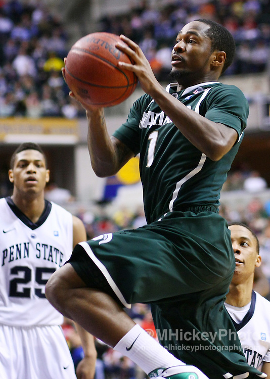 March 12, 2011; Indianapolis, IN, USA; Michigan State Spartans guard Kalin Lucas (1) goes up for a shot against the Penn State Nittany Lions in the semi-final round of the 2011 Big Ten Tournament at Conseco Fieldhouse. Penn State defeated Michigan State 61-48. Mandatory credit: Michael Hickey-US PRESSWIRE