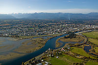 An aerial view of the Comox Valley shows the reason for the tremendous appeal of the region, combining ocean to mountain all within forty five minutes of each other.  Courtenay, The Comox Valley, Vancouver Island, British Columbia, Canada.