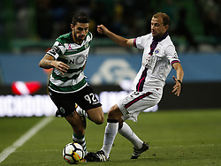 October 22, 2017 - Lisbon, Portugal - Sporting's defender Cristiano Piccini (L)  (C) vies for the ball with Chaves's defender Paulinho (R)  during Primeira Liga 2017/18 match between Sporting CP vs GD Chaves, in Lisbon, on October 22, 2017. (Credit Image: © Carlos Palma/NurPhoto via ZUMA Press)
