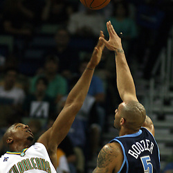 Carlos Boozer #5 of the Utah Jazz shoots over the out reached arm of New Orleans Hornets forward David West #30 in the first half of their NBA game on April 8, 2008 at the New Orleans Arena in New Orleans, Louisiana.