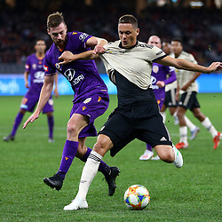 Nemanja Matic of Manchester United battles for the ball with Jacob Tratt of Perth Glory