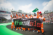 October 27-29, 2017: Mexican Grand Prix. Marshals show support for Mexico after the 2017 Earthquakes