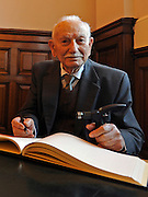 "© Licensed to London News Pictures. 02/02/2012, Kingston Upon Thames, UK. 104 year-old becomes Britain's oldest new citizen. Mr Khanjar signs the register. 104 year-old TAUFEEK KHANJAR became a British Citizen at a ceremony held by Surrey County Council today (01 February 2012). Mr Khanjar is originally from Iraq and worked as a jewellery maker in Baghdad. He came to the UK six years ago to live with his daughter Nada Dabis, 59, in South Cheam, Surrey, where he enjoys walking, feeding the birds, playing cards and listening to music. He is a widower with four sons and two daughters. Durning the ceremony Mr Khanjar took an oath to the Queen, pledging that he will be a faithful citizen and obey the laws of the country. He explained the secret to a long and healthy life was to ""never get stressed and be relaxed"".  Photo credit : Stephen Simpson/LNP"