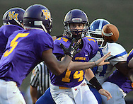 Upper Moreland's Casey Dekcer #14 flips the football to Rodney Morgan #5 in the first quarter against Conwell-Egan Catholic at Upper Moreland High School Friday September 18, 2015 in Willow Grove, Pennsylvania.  (Photo by William Thomas Cain)