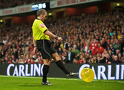 LONDON, ENGLAND - Wednesday, October 28, 2009: Referee Alan Wiley kicks off a ball from the pitch during the League Cup 4th Round match against Arsenal at Emirates Stadium. (Photo by David Rawcliffe/Propaganda)