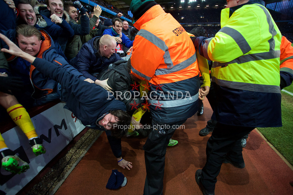 BIRMINGHAM, ENGLAND - Saturday, January 17, 2015: Liverpool's Rickie Lambert [hidden] celebrates scoring the second goal against Aston Villa with the travelling supporters during the Premier League match at Villa Park. (Pic by David Rawcliffe/Propaganda)