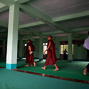 May 14, 2013 - Mandalay, Myanmar: Buddhist monks at Mosayein Monastery in central Mandalay. The city, famous for its pagodas, is a popular tourist destination for buddhist devotees from all over Southeast Asia. CREDIT: Paulo Nunes dos Santos