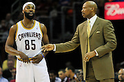 March 27, 2011; Cleveland, OH, USA; Cleveland Cavaliers point guard Baron Davis (85) talks with Cleveland Cavaliers head coach Byron Scott during the second quarter against the Atlanta Hawks at Quicken Loans Arena. Mandatory Credit: Jason Miller-US PRESSWIRE