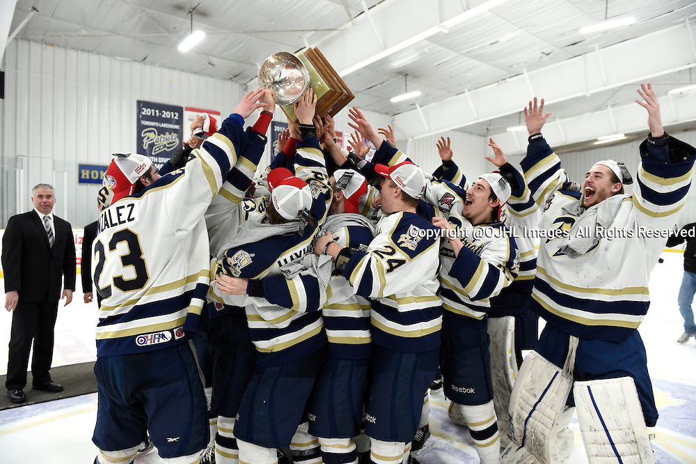 TORONTO, ON - Apr 22, 2015 : Ontario Junior Hockey League game action between the Toronto Patriots and the Kingston Voyaguers. Game seven of the Buckland Cup Championship Series. 2014-2015 Toronto Patriots celebrate with the Buckland Cup.<br /> (Photo by Andy Corneau / OJHL Images)