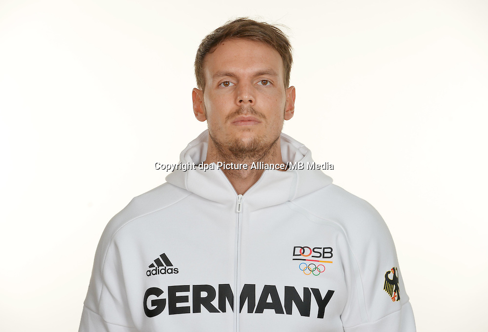 Kai Häfner poses at a photocall during the preparations for the Olympic Games in Rio at the Emmich Cambrai Barracks in Hanover, Germany. July 27, 2016. Photo credit: Frank May/ picture alliance. | usage worldwide