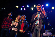 "Minneapolis Mayor R.T. Rybak, right, speaks to the audience during his ""Unauguration Party"" at First Avenue, Wednesday, December 18, 2013. Alongside Rybak are, right to left, his wife Megan O'Hara, daughter Gracie, and son Charlie."