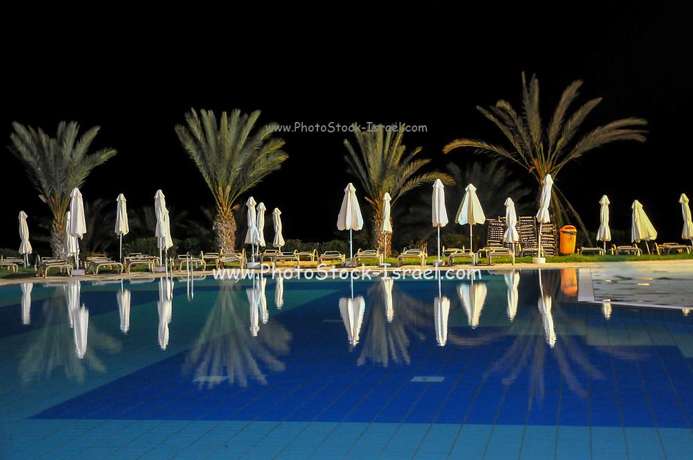 Swimming pool at a resort hotel at night. Paphos, Cyprus
