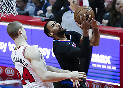 March 15, 2019 - Los Angeles, California, U.S - Los Angeles ClippersÃ• Garrett Temple (17) goes to basket against Chicago Bulls' Lauri Markkanen (24) during an NBA basketball game between Los Angeles Clippers and Chicago Bulls Friday, March 15, 2019, in Los Angeles. The Clippers won 128-121. (Credit Image: © Ringo Chiu/ZUMA Wire)