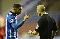 Wigan Athletic's Jermaine Pennant protests to Referee Andy Woolmer - Photo mandatory by-line: Richard Martin-Roberts/JMP - Mobile: 07966 386802 - 24/02/2015 - SPORT - Football - Wigan - DW Stadium - Wigan Athletic v Cardiff City - Sky Bet Championship