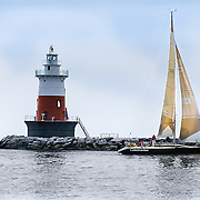 The lighthouse and the sailboat in the storm.<br />
