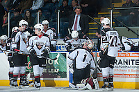 KELOWNA, CANADA - MARCH 15: Don Hay, head coach of the Vancouver Giants stands on the bench during first period as goaltender Payton Lee #1 receives an equipment adjustment after the first goal against the Giants on March 15, 2014 at Prospera Place in Kelowna, British Columbia, Canada.   (Photo by Marissa Baecker/Getty Images)  *** Local Caption *** Don Hay; Payton Lee;