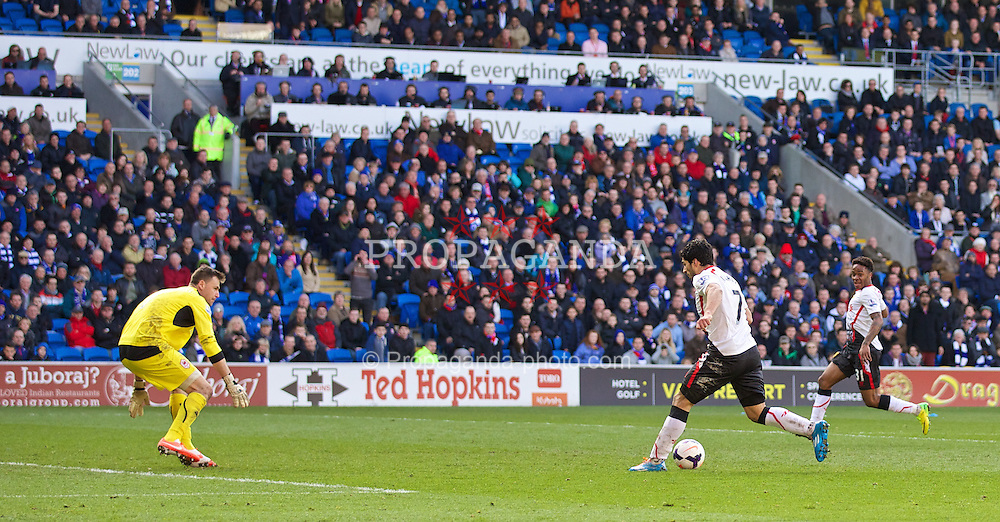 CARDIFF, WALES - Saturday, March 22, 2014: Liverpool's Luis Suarez scores the sixth goal, the third of his hat-trick, against Cardiff City during the Premiership match at the Cardiff City Stadium. (Pic by David Rawcliffe/Propaganda)