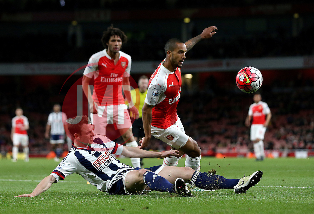 Theo Walcott of Arsenal is tackled by Jonny Evans of West Bromwich Albion - Mandatory by-line: Robbie Stephenson/JMP - 21/04/2016 - FOOTBALL - Emirates Stadium - London, England - Arsenal v West Bromwich Albion - Barclays Premier League