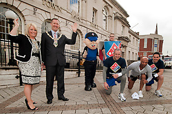 Dominos staff Set off from Rotherham Town Hall on Saturday Morning on a sponsored run to rais funds for the Mayors Three Charities from Left to right Mayoress of Rotherham Lisa Wright, Mayor Cllr Shaun Wright, Mascot Danny Dominos, Pizza box Anthony Shepherd, Runner Eddie Lamaa, Trainer Alli Urfan of Boot camp UK and Runner Henri Salameh.120601-1 Pizza Run for mayors Charity..http://www.pauldaviddrabble.co.uk.14 April 2012 .Image © Paul David Drabble