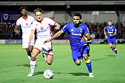 AFC Wimbledon striker Andy Barcham (17) battles for possession with Milton Keynes Dons attacker Callum Brittain (25) during the EFL Sky Bet League 1 match between AFC Wimbledon and Milton Keynes Dons at the Cherry Red Records Stadium, Kingston, England on 22 September 2017. Photo by Matthew Redman.