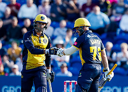 Jeremy Lawlor of Glamorgan punches gloves with team-mate  David Lloyd<br /> <br /> Photographer Simon King/Replay Images<br /> <br /> Vitality Blast T20 - Round 1 - Glamorgan v Somerset - Thursday 18th July 2019 - Sophia Gardens - Cardiff<br /> <br /> World Copyright © Replay Images . All rights reserved. info@replayimages.co.uk - http://replayimages.co.uk