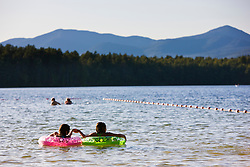 Kids float at the beach at White Lake State Park in Tamworth, New Hampshire.