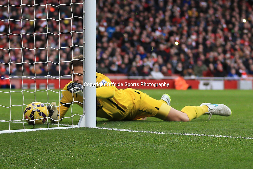11 January 2015 - Barclays Premier League - Arsenal v Stoke City - Asmir Begovic of Stoke City spills the ball into his on net - Photo: Marc Atkins / Offside.