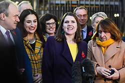 © Licensed to London News Pictures. 30/10/2019. LONDON, UK.  Jo Swinson, Leader of the Liberal Democrats, (C), addresses the media outside the Houses of Parliament.  She stood with senior members of her party, as the Lib Dems launched their election campaign ahead of the General Election on 12 December.  Photo credit: Stephen Chung/LNP