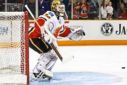 March 23, 2011; San Jose, CA, USA;  Calgary Flames goalie Miikka Kiprusoff (34) warms up before the game against the San Jose Sharks at HP Pavilion. Mandatory Credit: Jason O. Watson / US PRESSWIRE