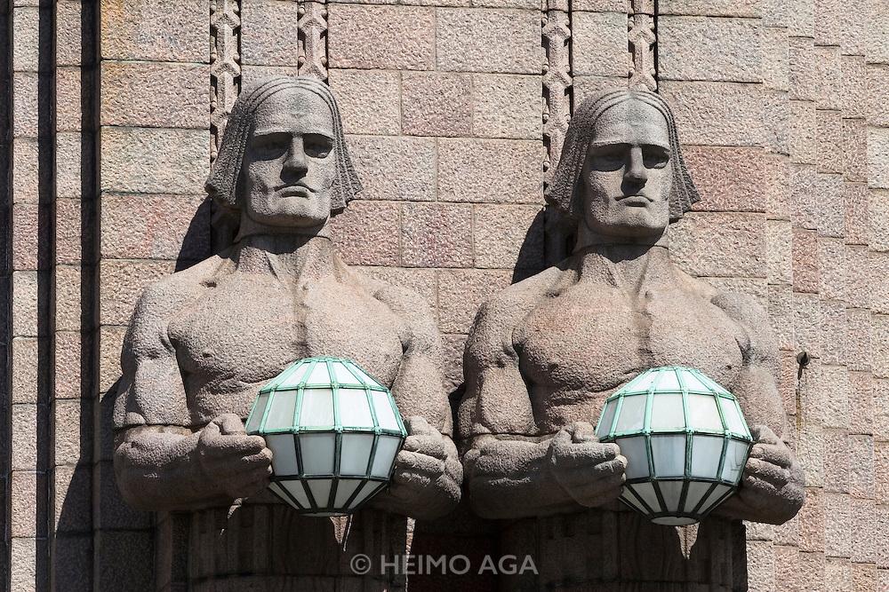 Helsinki Central Railway Station. Art deco style building by architect Eliel Saarinen. The famous lamp holding giants.