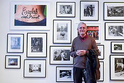 "London, UK.  17 May 2017. Martin Parr, Magnum photographer, stands in front of a collection of works by variosu photographers. Parr's work ""English and Proud"" is seen top left. Preview of Photo London 2017 at Somerset House.  Held for the third time, the event showcases the best in contemporary photography, from 89 galleries from 16 different countries, for collectors and enthusiasts and will be on from 18 - 21 May. Credit: Stephen Chung / Alamy Live News"