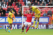 AFC Wimbledon defender Darius Charles (32) battles for possession with Charlton Athletic striker Josh Magennis (9) during the EFL Sky Bet League 1 match between Charlton Athletic and AFC Wimbledon at The Valley, London, England on 28 October 2017. Photo by Matthew Redman.