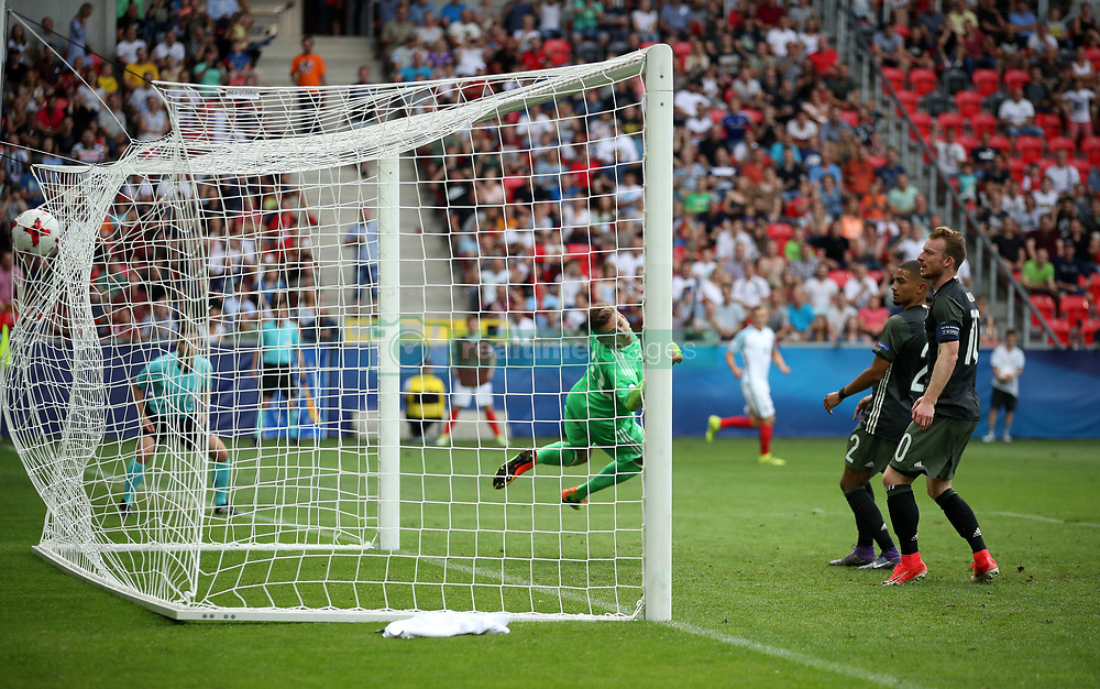 England's Demarai Gray (not in picture) scores his side's first goal of the game past Germany's Julian Pollersbeck during the UEFA European Under-21 Championship, Semi Final match at Stadion Miejski, Tychy.