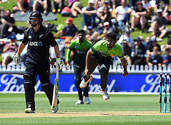 Pakistan's Hasan Ali, right, bowls past New Zealand's Colin Munro in the first one day cricket international at the Basin Reserve, Wellington, New Zealand, Saturday, January 06, 2018. Credit:SNPA / Ross Setford  **NO ARCHIVING**