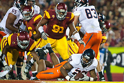 September 11, 2010; Los Angeles, CA, USA;  Virginia Cavaliers running back Keith Payne (22) dives into the end zone for a touchdown against the against the Southern California Trojans during the second quarter at the Los Angeles Memorial Coliseum.