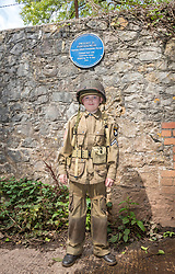 © Licensed to London News Pictures; 20/08/2020; Weston-super-Mare, UK. IVAN JEFFREY age 10 wearing the uniform of the 101st Airborne and a member of the Airborne Misfit re-enactment group, helps unveil a plaque to former US President Dwight D. Eisenhower which has been installed, with Weston Mayor and Mayoress in attendance, in Weston Woods near the water tower to commemorate the time that he stayed the night nearby with US troops as Supreme Allied Commander in preparation for D-Day in World War Two. Dwight D Eisenhower is the only American President to have set foot in Weston-super-Mare. As Supreme Allied Commander Europe he arrived in Weston towards the close of World War Two and stayed one night in 1944, en-route to the D-Day landings. The town was filled with American servicemen. Officers were billeted in hotels whilst other ranks slept under canvass in Ellenborough Park. Far from throwing around his status 'Ike' opted to sleep in a caravan parked near the water tower in Weston Woods, in the midst of military vehicles huddled under tree cover and along the Toll Road. Following the war, Eisenhower became NATO's first Supreme Commander and then President of the United States from 1953 until 1961. Photo credit: Simon Chapman/LNP.