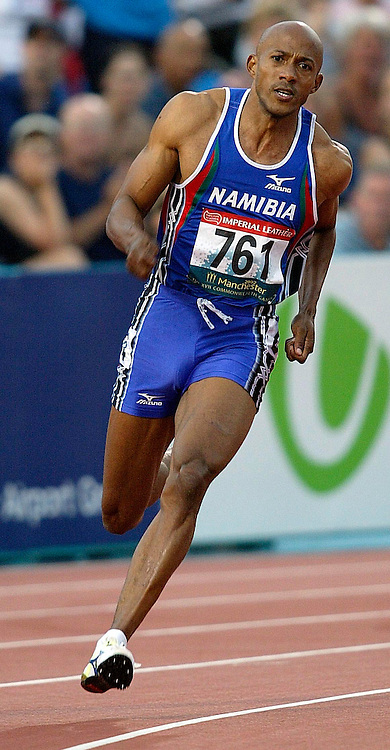 29 July 2002, City of Manchester stadium, Commonwealth Games, Manchester, England. Winner Frankie Fredericks on the bend of the 200m . <br />